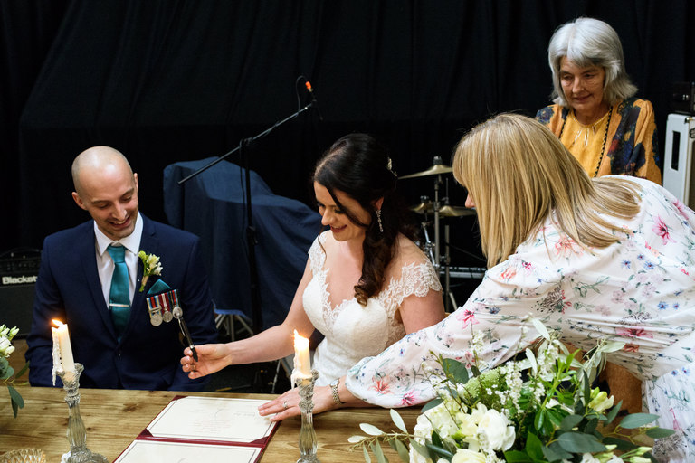 signing the register after humanist wedding