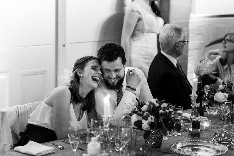 couple laughing during speeches