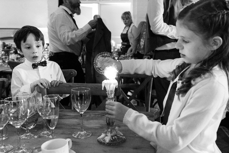 kids playing with candles at weddings
