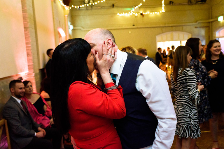 couple smooching on the dance floor
