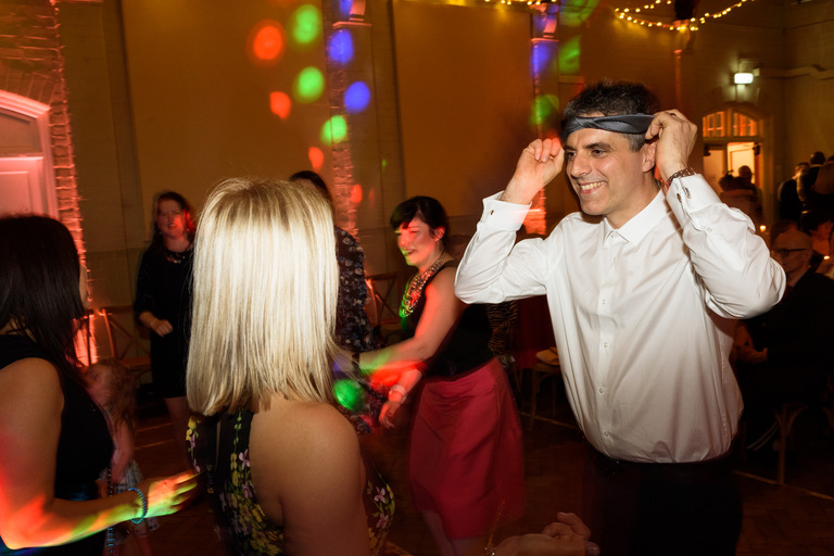 guy dancing with a tie around his head