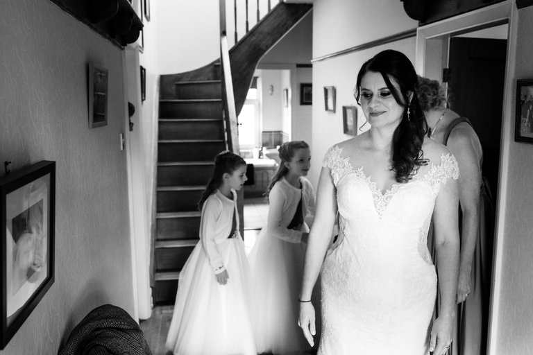 bride in dress getting ready at home