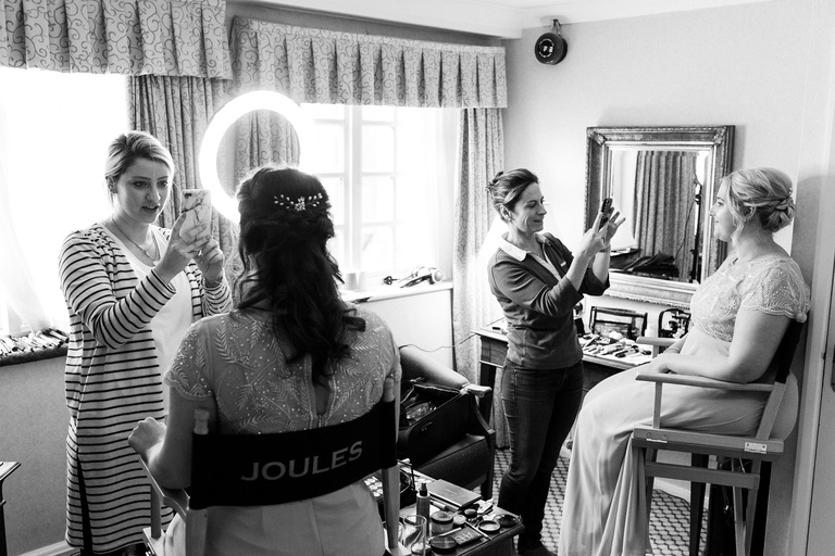 two makeup artists at work during bridal prep