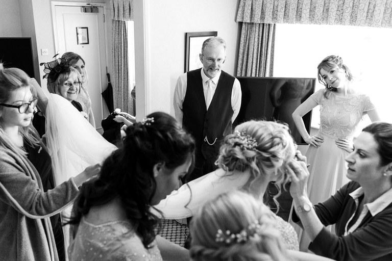 busy bridal prep scene with famliy