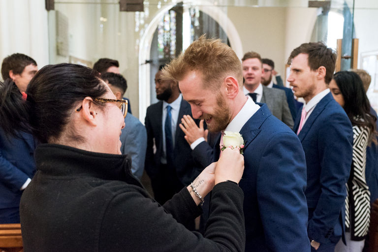 groom having button hole pinned