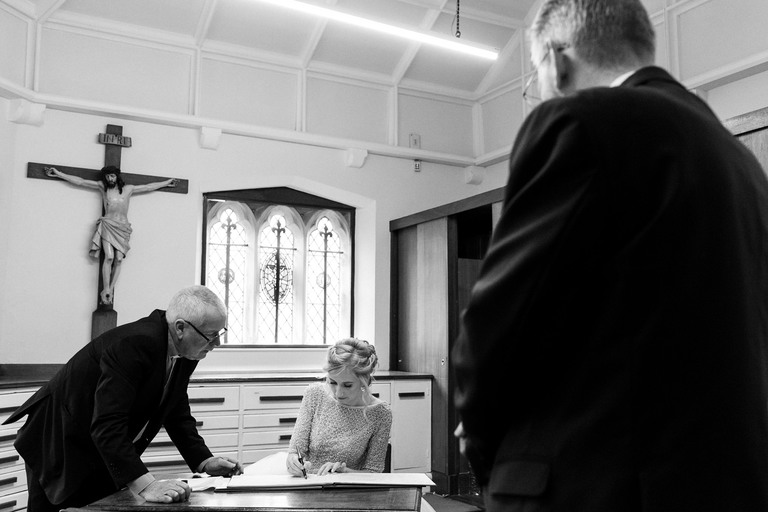 signing the register in the back room at st marys church