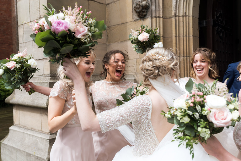 bride surrounded by cheering bridesmaids
