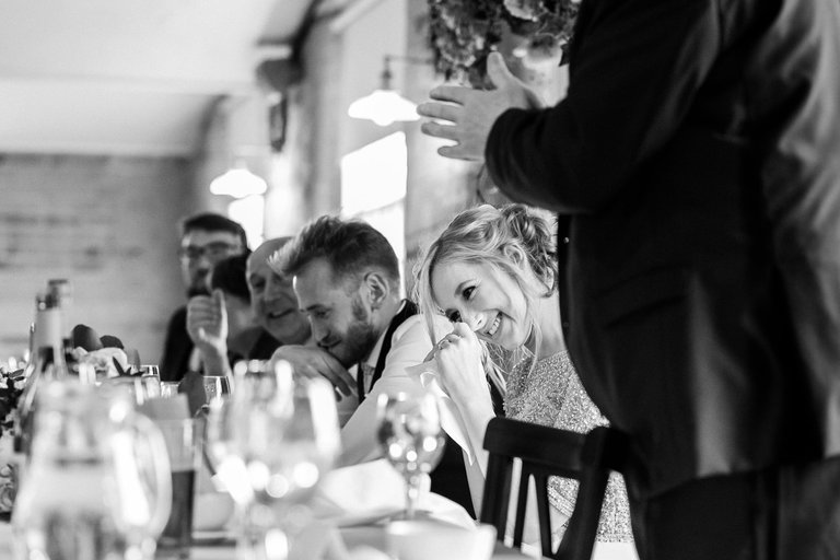 bride's happy tears during wedding speeches
