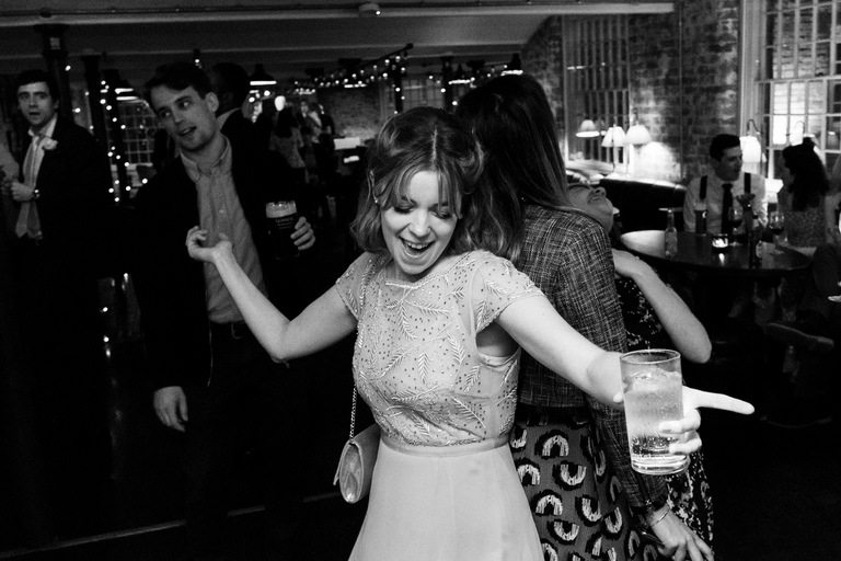 bridesmaid throwing shapes on the dancefloor