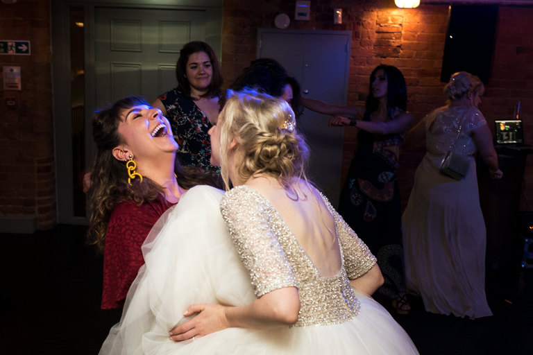 bride dancing with friend