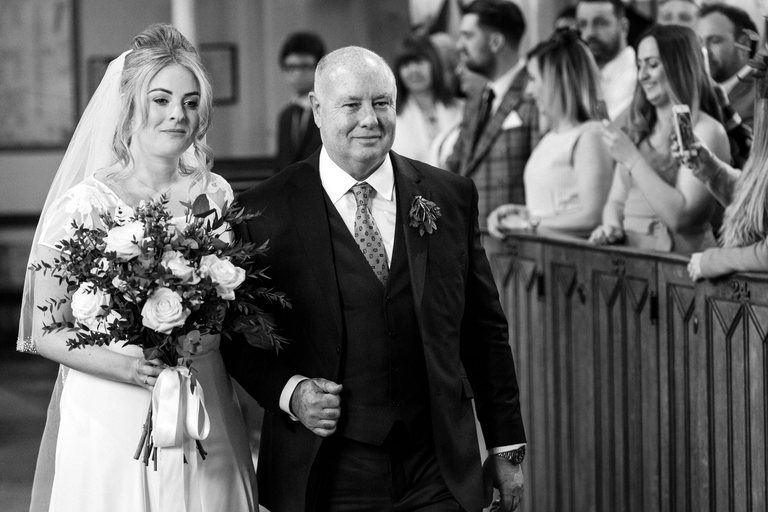 walking down the aisle with her proud father