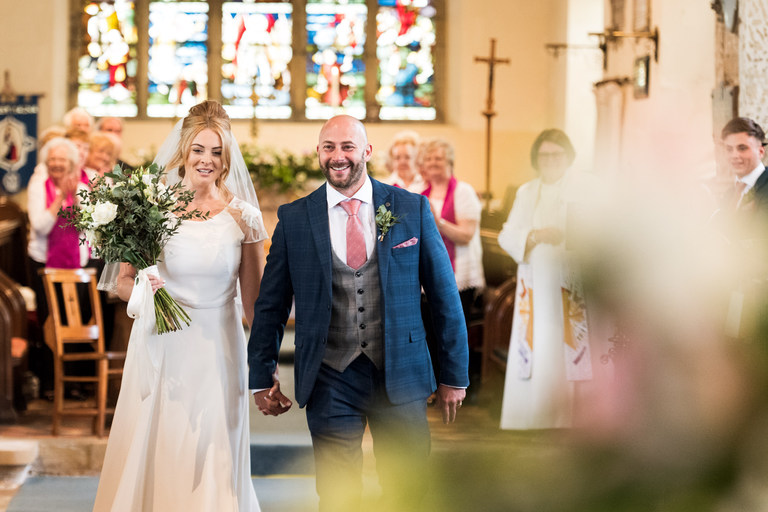 just married and walking down the aisle