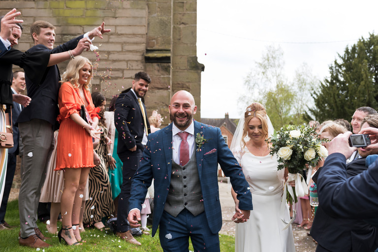 throwing confetti outside the church in appleby magna