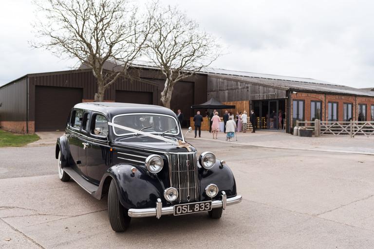 vintage wedding cars arriving at norton fields