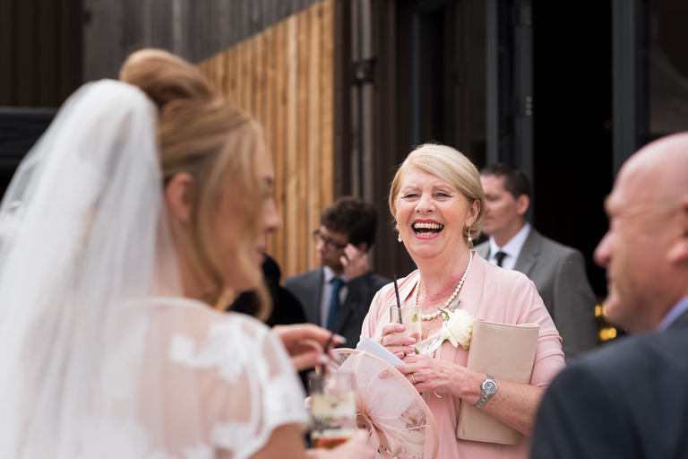 mother of the bride with a drink
