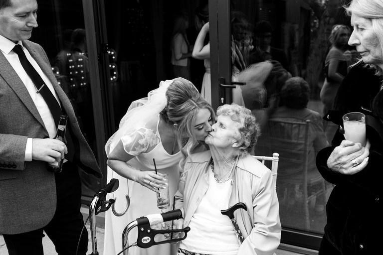 bride giving her nan a kiss