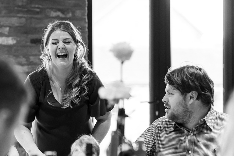 guests laughing at the tables