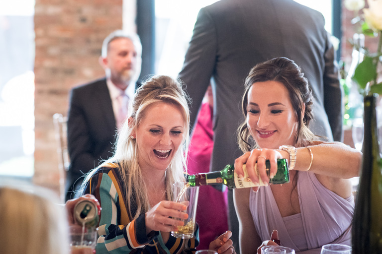 guests pouring jameson whisky