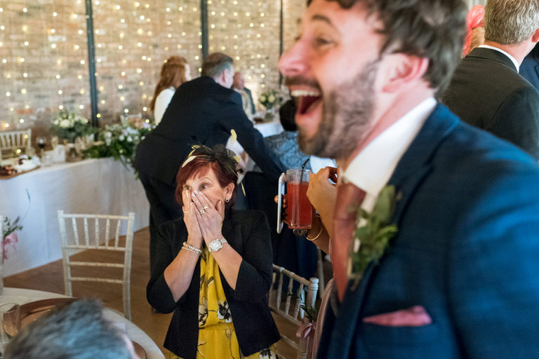 shocked guest at seeing the groom in a wig