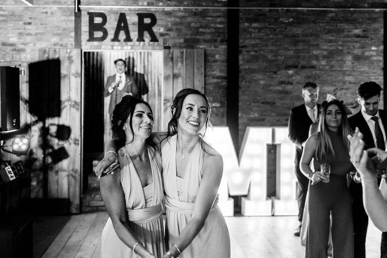 bridesmaids dancing together