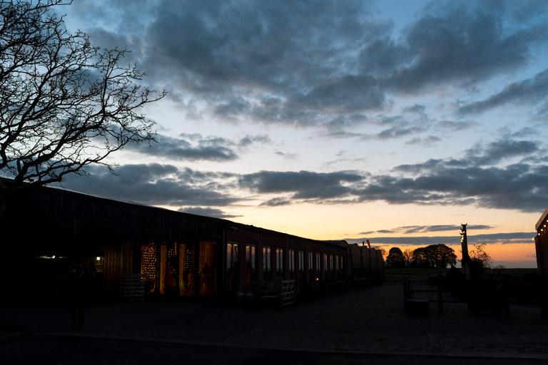 the setting sun over norton fields wedding venue in warwickshire