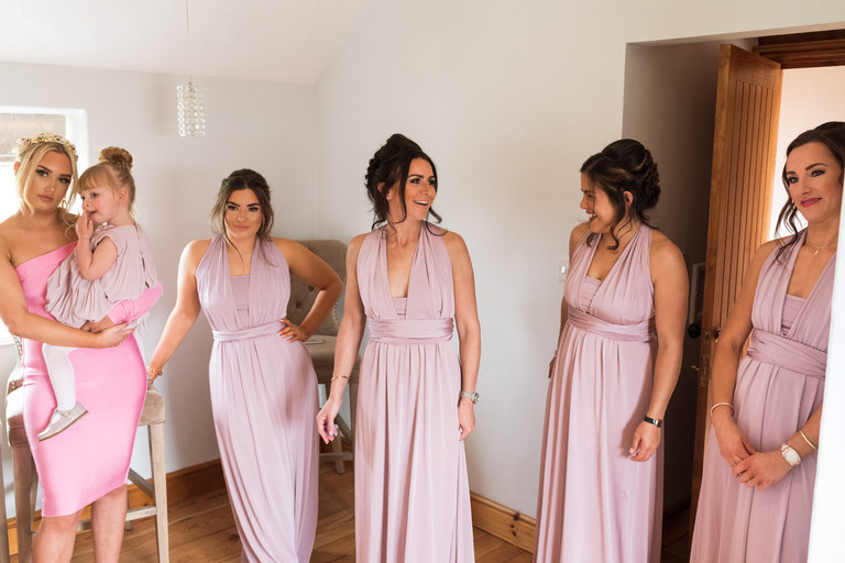 bridesmaids all ready in their dresses