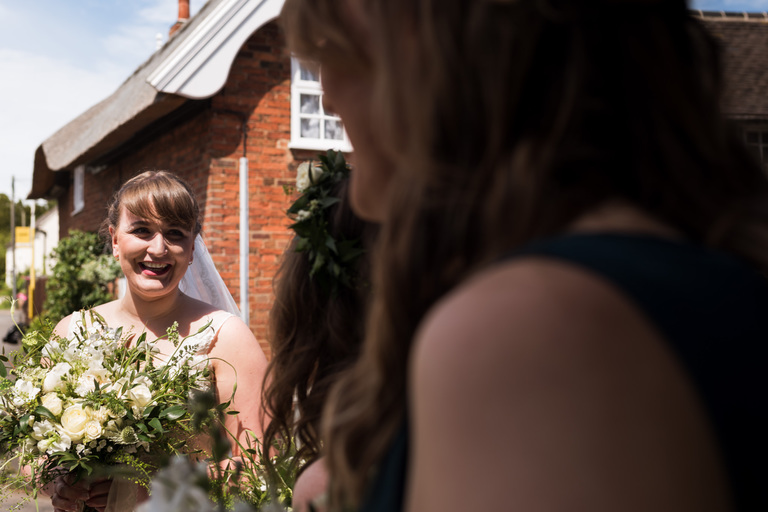 bride arriving at the church in the sunshine