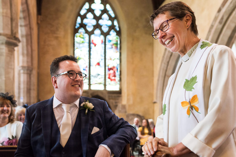 groom chatting with female vicar
