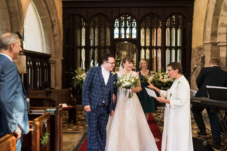 leading the bridal party down the aisle in church