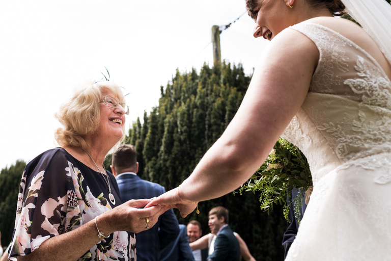 guest admiring the bride's wedding ring