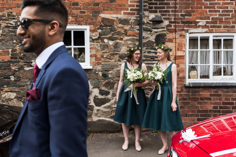 bridesmaids in flower crowns chatting on the street