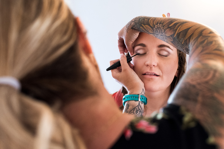 bride and a tattooed makeup artist