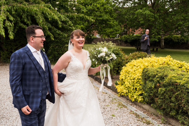 happy couple arriving at ticknall village hall