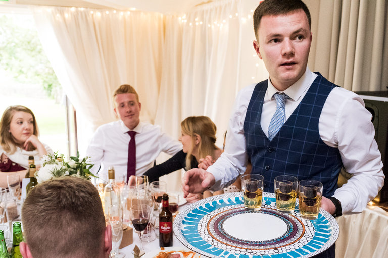 wedding guest buying a round of shots