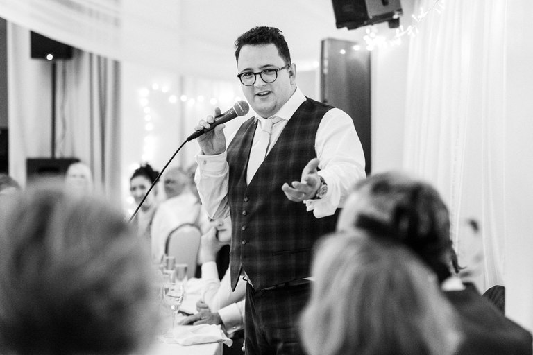 groom giving his speech looking at his wife