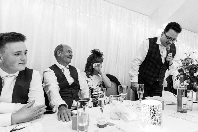 groom's mum wiping away tears during speeches