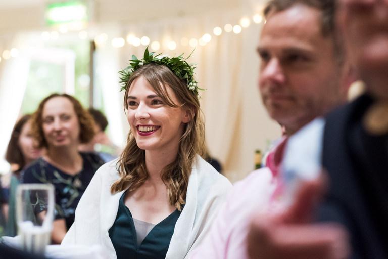 bridesmaid smiling watching speeches