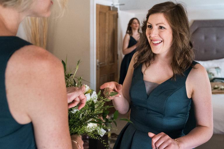 bridesmaids admiring flowers