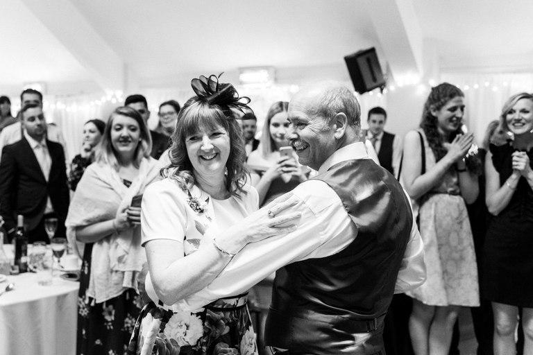 groom's parents dancing together