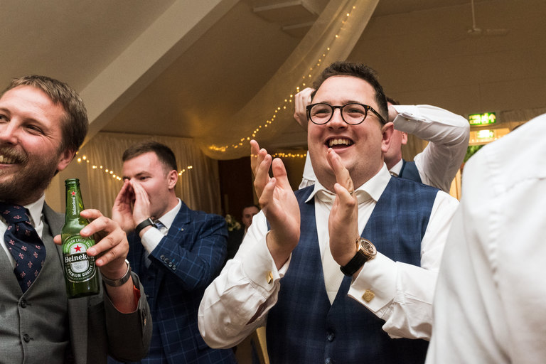 groom applauding