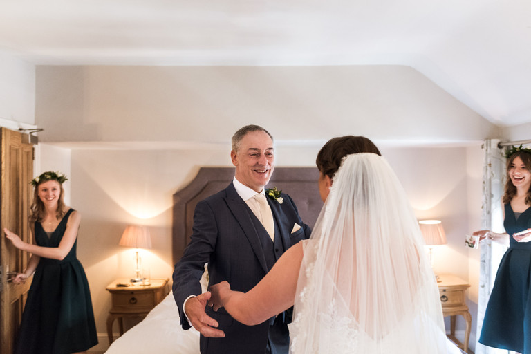 bride's father seeing his daughter in her dress