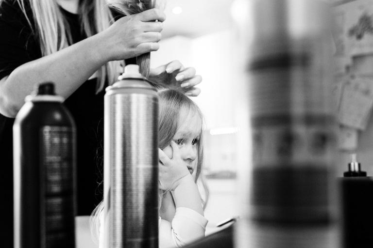 little girl bored having hair done