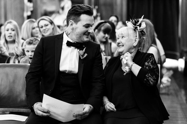 groom sat with his mum