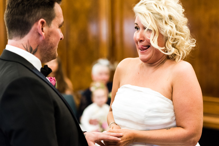 funny photo bride putting ring on