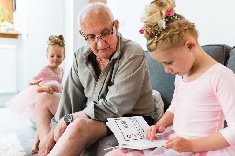 kids reading with grandad