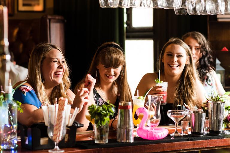 ladies ordering cocktails