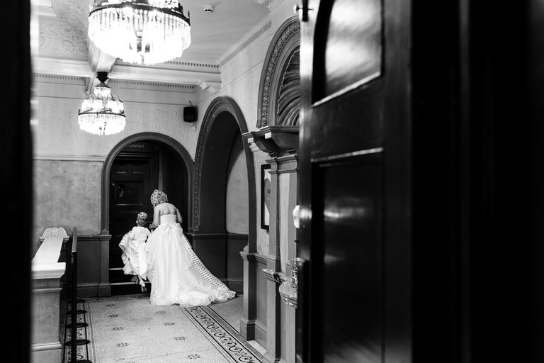 bride taking her daughter to the bathroom