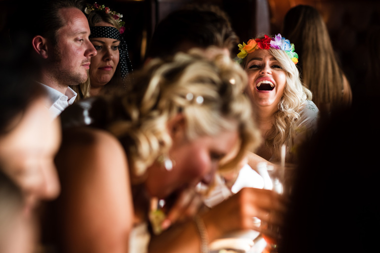 wedding guest with flowers in her hair