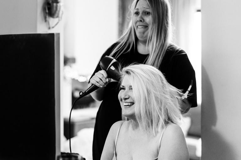 bride laughing having her hair styled
