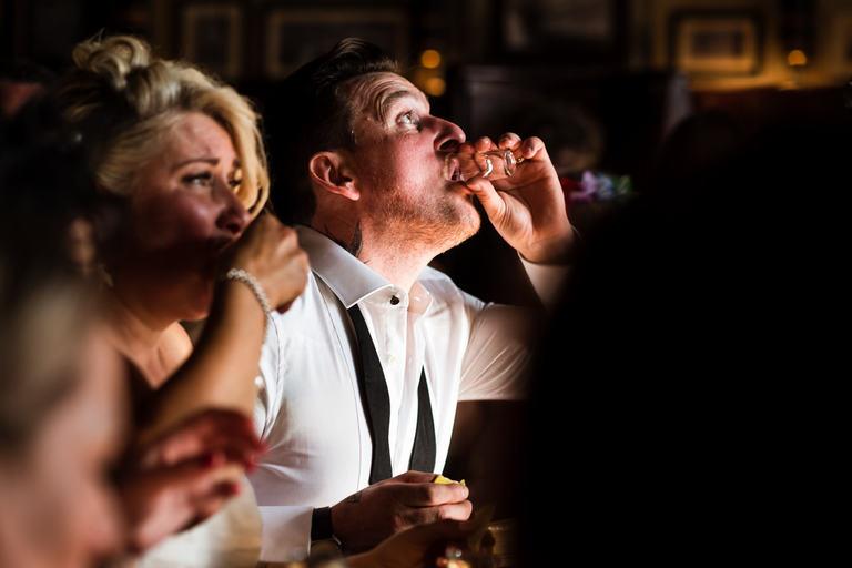 groom doing tequila slammers